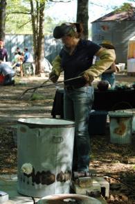 Kelly Landrum preparing her kiln for Raku