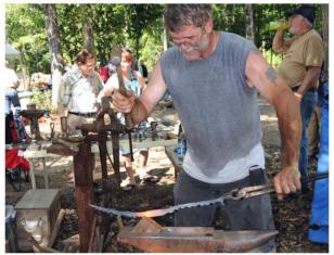 Working at the anvil during Fire in the Swamp 2009