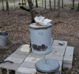 Raku kiln and pottery being pre-heated