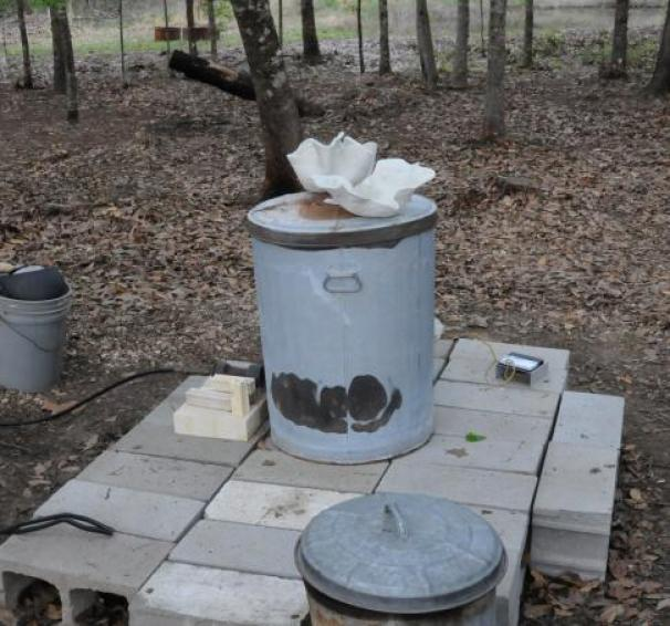 Raku kiln and pottery being pre-heated