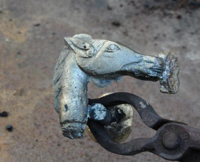 Freshly cast bronze horse-head cane handle